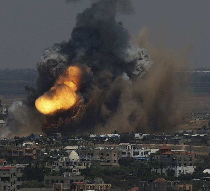 Smoke and flames are seen following what police said was an Israeli air strike in Rafah in the southern Gaza Strip