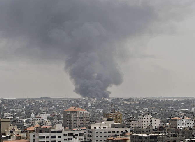 Smoke rises following an Israeli tank's shelling that hit the industrial area in the east of Gaza City.