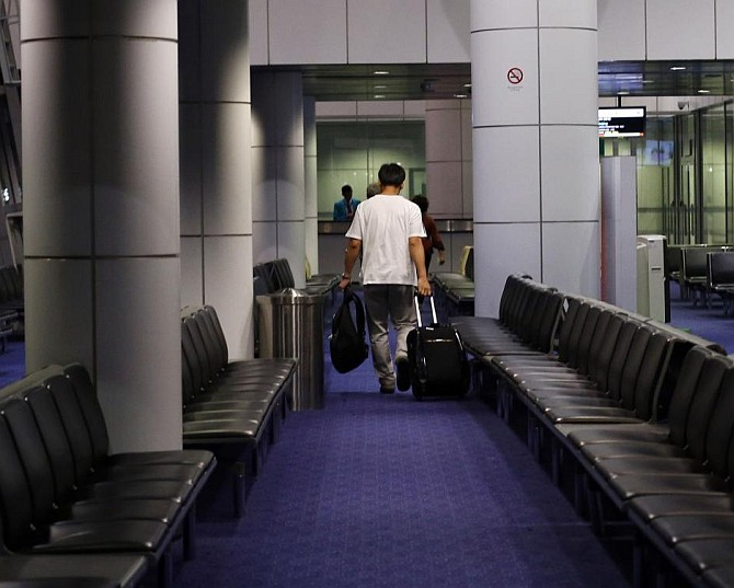 A passenger prepares to board a flight at Singapore airport. Photograph used only for representational purposes.