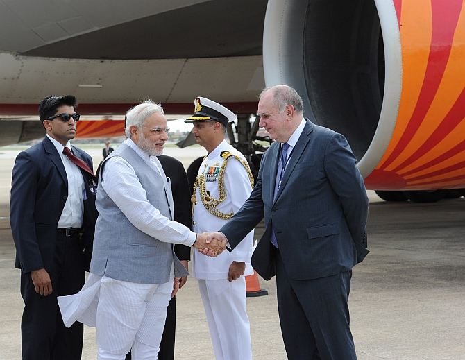 Modi is received by the chief BRICS coordinator in the Brazilian foreign affairs ministry, Luis Lopes on his arrival, at Fortaliza International Airport