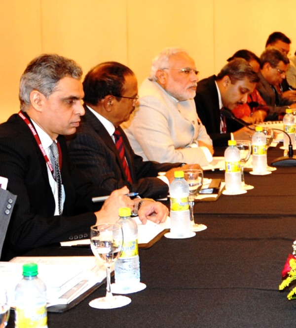Modi and MEA spokesperson Syed Akbaruddin at the meeting with Chinese officials
