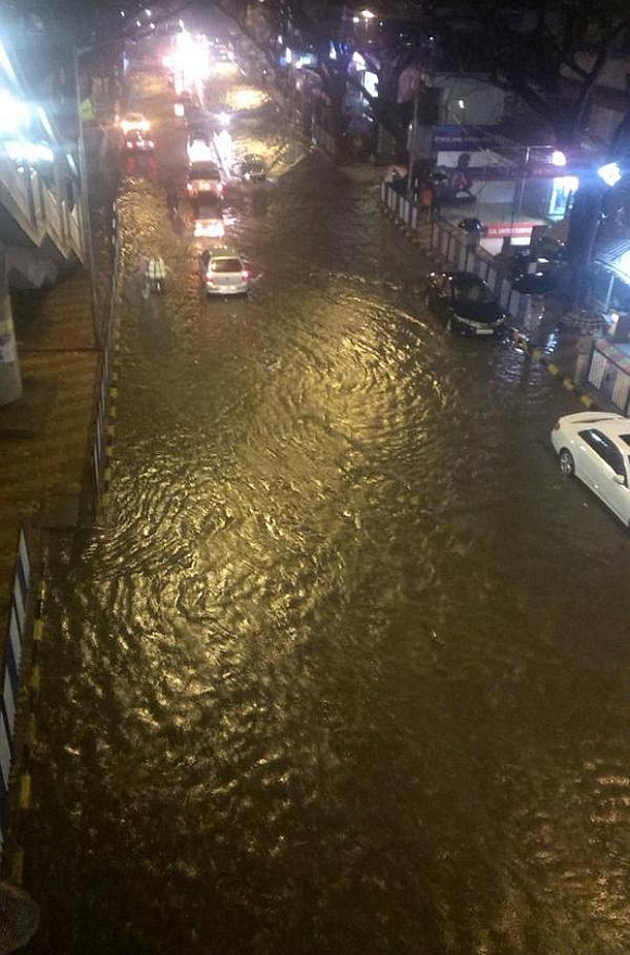 Flooding near the Metro station at S V Road in Andheri