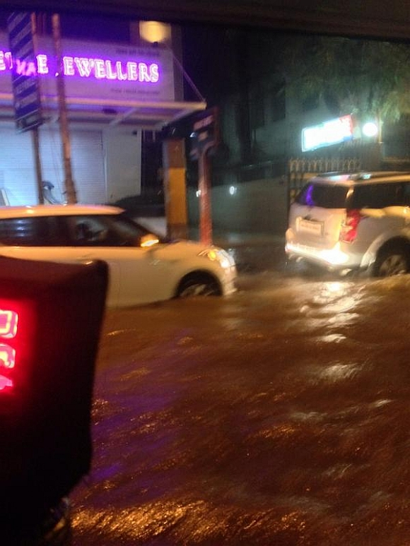 Knee-deep water slowed traffic outside Vile Parle station