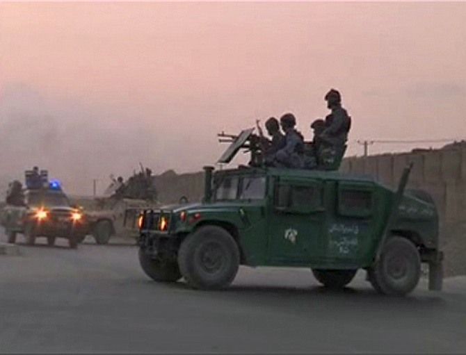 Afghan security personnel are seen on vehicles as an area near the Kabul airport comes under attack, in this still image taken from a Reuters TV video in Kabul