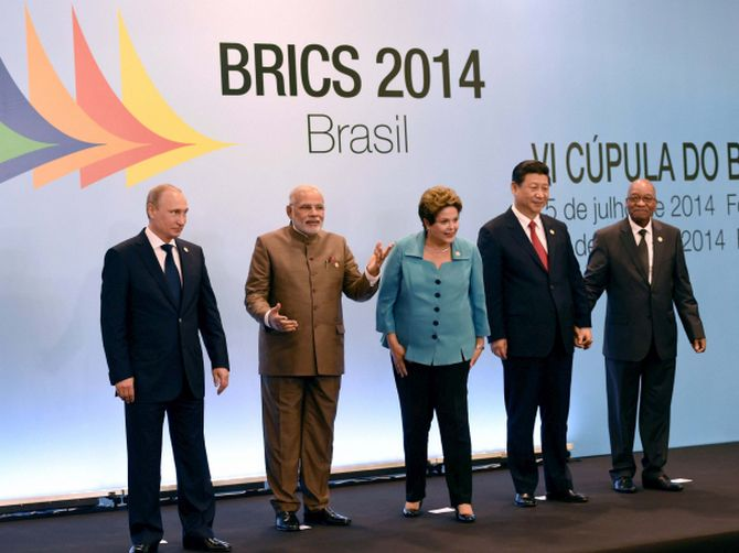 The five leaders smile as they pose for photographs during the summit
