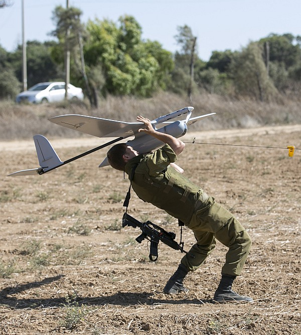 An Israeli soldier launches a Skylark unmanned aerial vehicle near the Israeli-Gaza Border