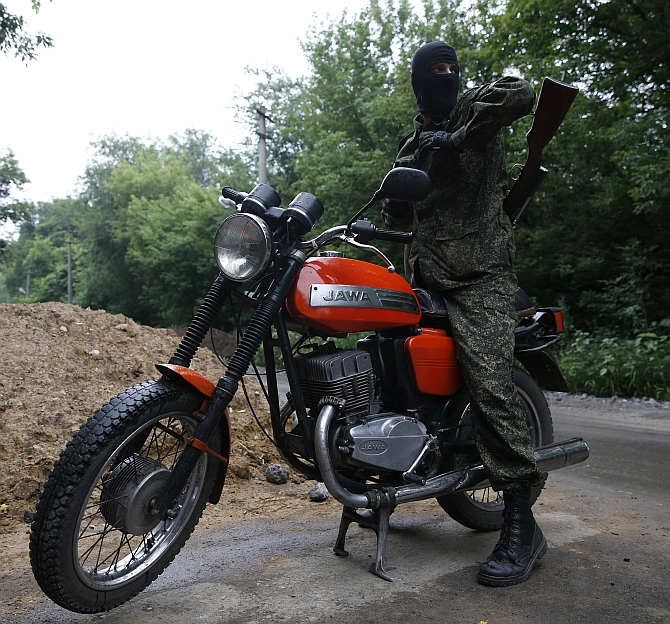 A pro-Russian fighter mans a checkpoint in the eastern Ukrainian city of Donetsk