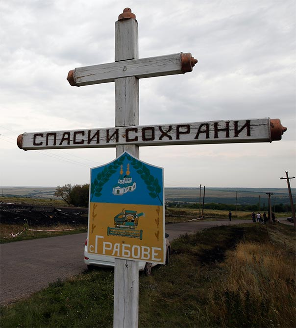 The village sign of Grabovo near the debris of the Malaysia Airlines Boeing 777.
