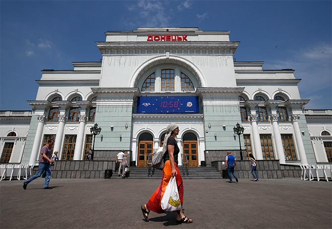 People walk past the train station in Donetsk.
