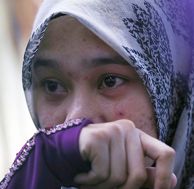 Atikah Abdul Rahman, 20, the niece of Captain Wan Amran, who was on board Malaysia Airlines flight MH17, arrives at Kuala Lumpur International Airport in Sepang July 18