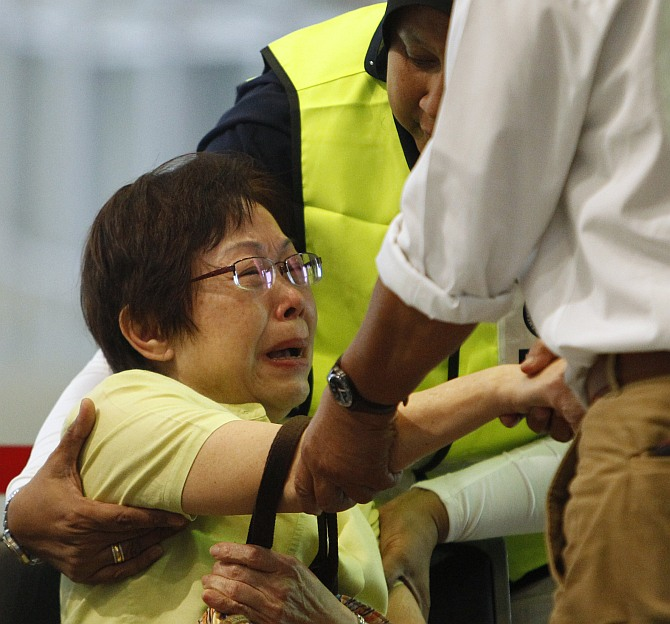 MH17 crash: Tears of disbelief hit relatives