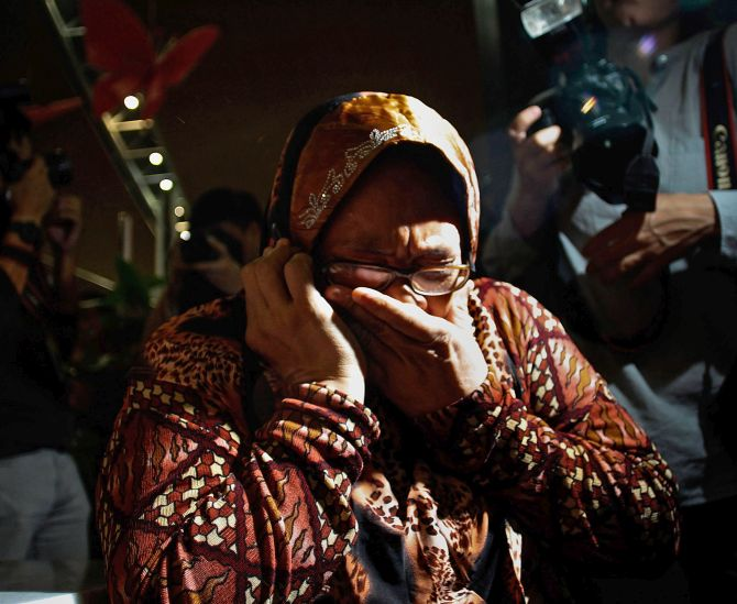A Malaysian woman weeps after she hears of the crashing of the plane.