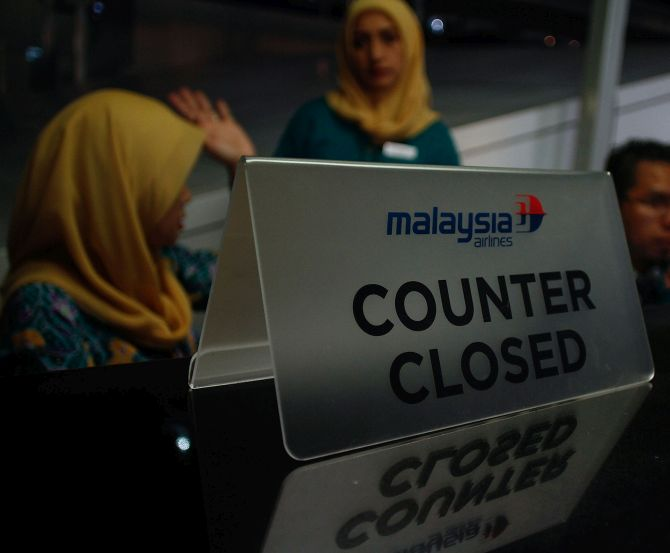 Counters of Malaysia Airlines remain shut after flight MH17 was shot down