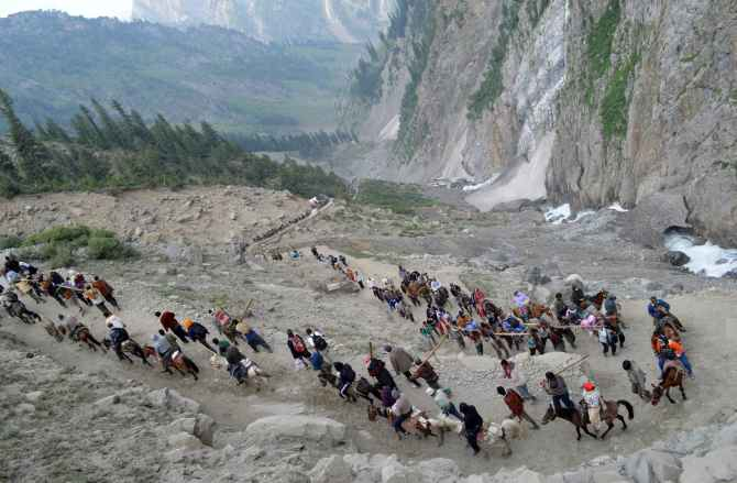 Pilgrims proceed towards the Holy Amarnath shrine from Baltel route on Saturday