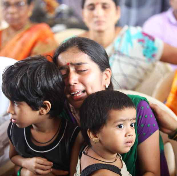 The grieving family members of firefighter Nitin Ivalekar on Saturday