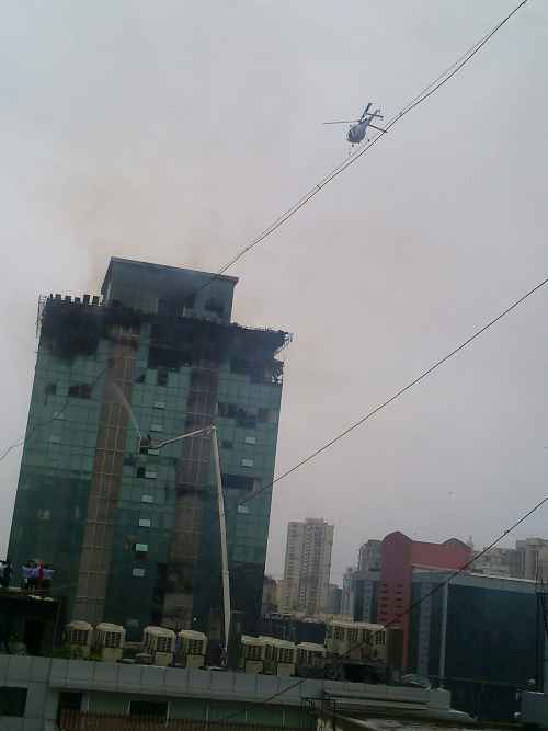 Navy chopper in action to rescue trapped firemen at Lotus Business Park in Mumbai on Friday
