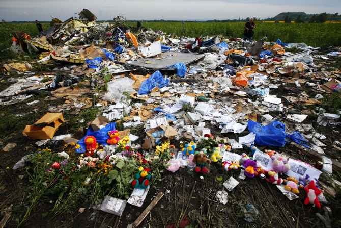 Flowers and mementos left by local residents at the crash site of Malaysia Airlines Flight MH17