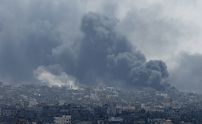 Smoke rises during what witnesses said were heavy Israeli shelling at the Shejaia neighbourhood in Gaza City