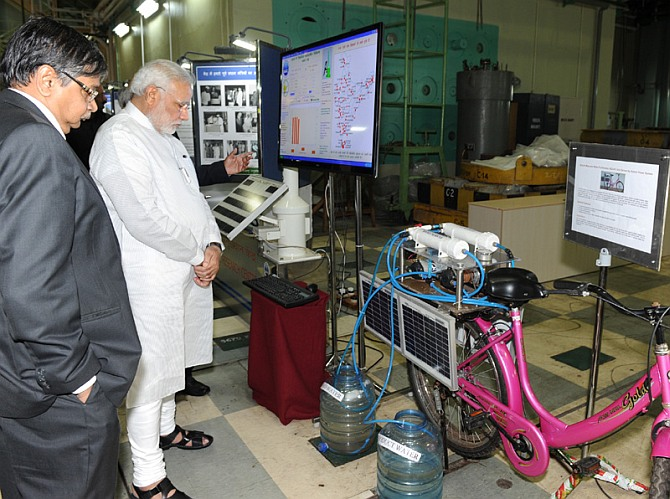 PM Modi examines a solar-based technology demonstrator at BARC