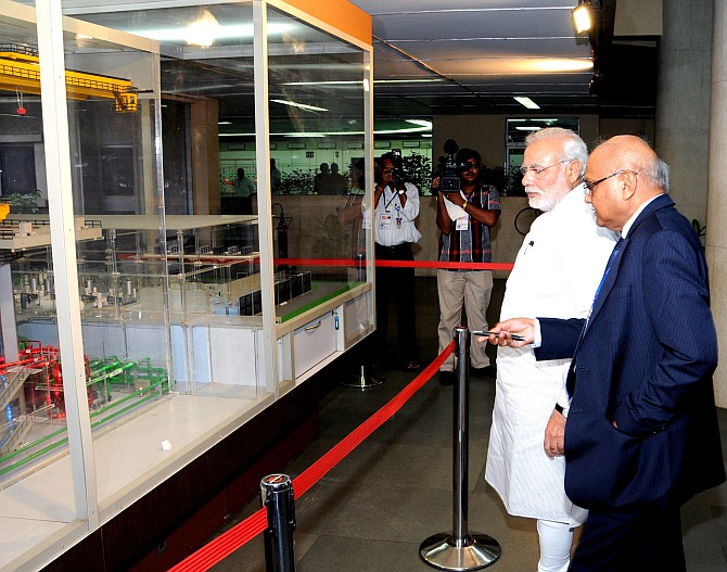 PM Narendra Modi being briefed by the Secretary DAE and Chairman, AEC, Dr R K Sinha, about the Dhruva Reactor at the Bhabha Atomic Research Centre