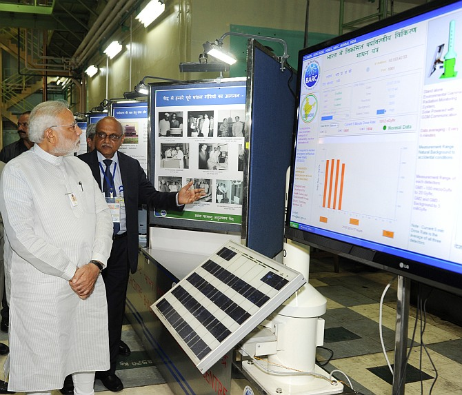 Prime Minister Modi being briefed about BARC exhibition