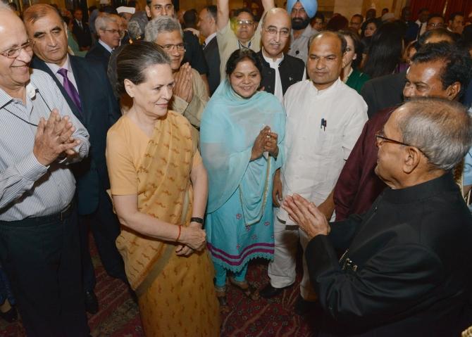 President Pranab Mukherjee greets Congress president Sonia Gandhi