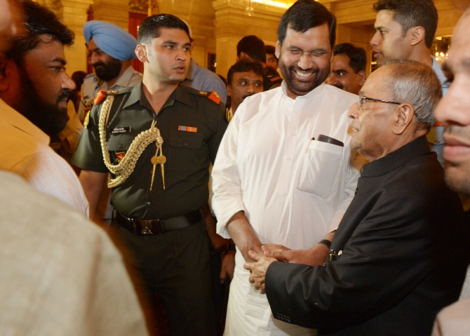 Lok Janashakti Party leader Ram Vilas Paswan shares a light moment with President Pranab Mukherjee