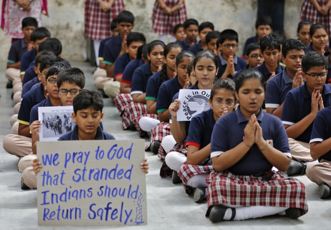 School students pray for the Indian citizens kidnapped in Iraq, at a school in Ahmedabad.