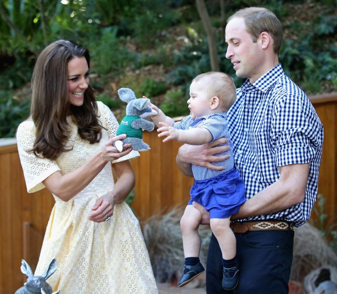 Prince George is king of the world on his first birthday