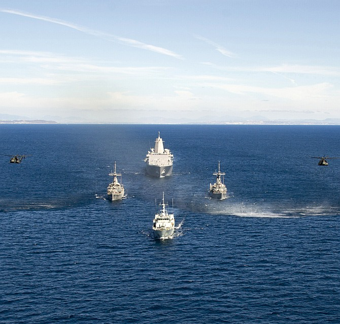 San Antonio-class amphibious transport dock ship USS Anchorage (LPD 23), Avenger-class mine countermeasures ships USS Scout (MCM 8) and USS Champion (MCM 4), and Canadian Forces Kingston-Class coastal defense vessel HMCS Nanaimo (MM 702) transit in formation off the coast of Southern California as part of Rim of the Pacific Exercise 2014.
