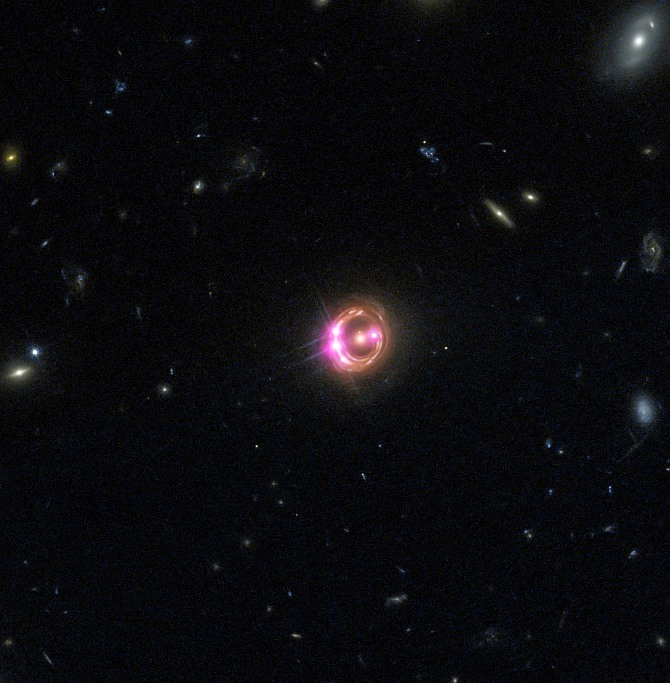 Multiple images of a distant quasar are visible in this combined view from NASA's Chandra X-ray Observatory and the Hubble Space Telescope. The Chandra data were used to directly measure the spin of the supermassive black hole powering this quasar. This is the most distant black hole where such a measurement has been made, as reported in our press release.
