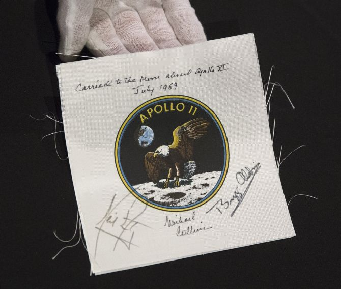 An Apollo 11 emblem, flown into lunar orbit and signed by the crew - Neil Armstrong, Michael Collins, and Buzz Aldrin, is displayed as part of the upcoming Space History Sale at Bonham's auction house in New York.