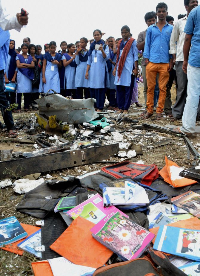 Books and other belongings of the school kids aboard the bus strewn on the ground