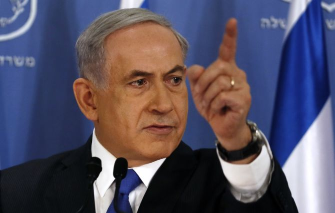 Israeli Prime Minister Benjamin Netanyahu gestures as he speaks during a news conference at the defense ministry in the Israeli coastal city of Tel Aviv