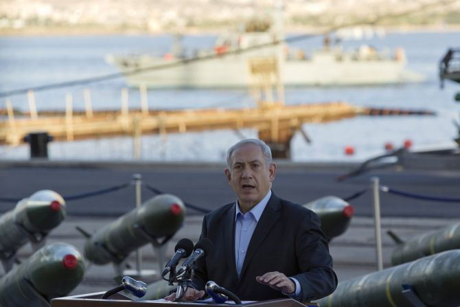 Israel's Prime Minister Benjamin Netanyahu speaks to the media in front of a display of M302 rockets, found aboard the Klos C ship, at a navy base in the Red Sea resort city of Eilat