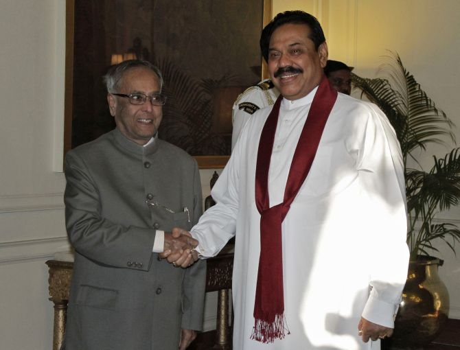 Sri Lanka's President Mahinda Rajapaksa (R) shakes hands with his Indian counterpart Pranab Mukherjee during their meeting at India's presidential palace Rashtrapati Bhavan in New Delhi September 20, 2012