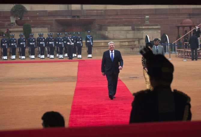 German President Joachim Gauck walks on the red carpet during his ceremonial reception at the forecourt of India's Rashtrapati Bhavan presidential palace in New Delhi February 5, 2014.
