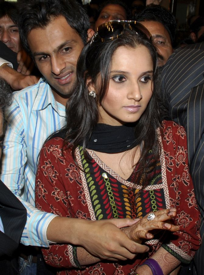 Sania walks with her husband Malik