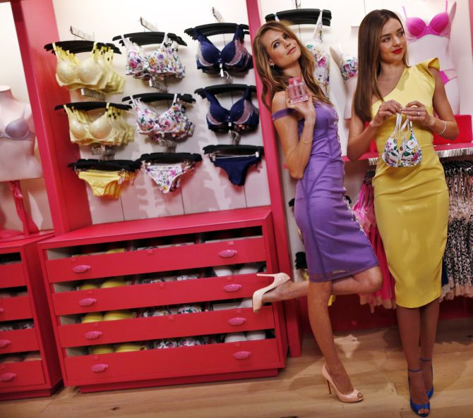 Victoria's Secret models Behati Prinsloo and Miranda Kerr at the company's flagship store in New York.