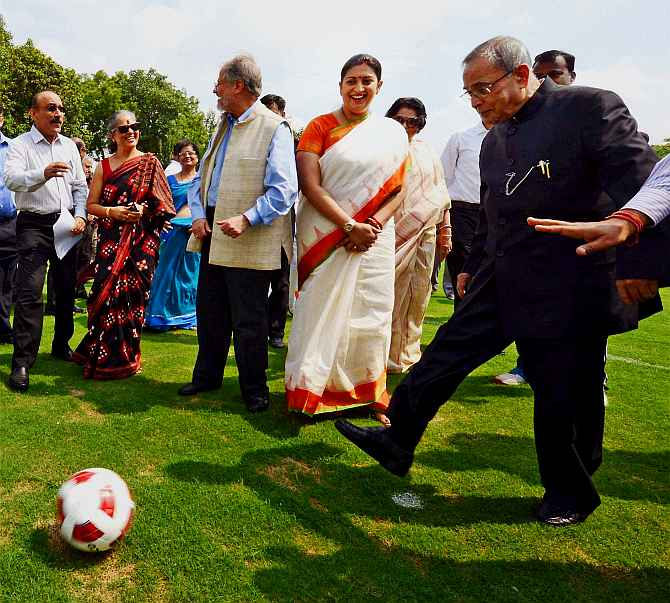 President Pranab Mukherjee kicks a football as HRD Minister Smriti Irani looks on during inauguration of various facilities in Rashtrapati Bhavan on Friday.