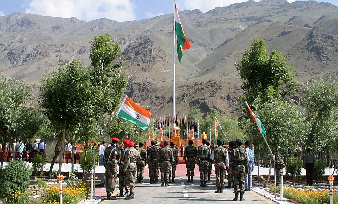 Army officers pay tribute at the war memorial in Drass on Friday