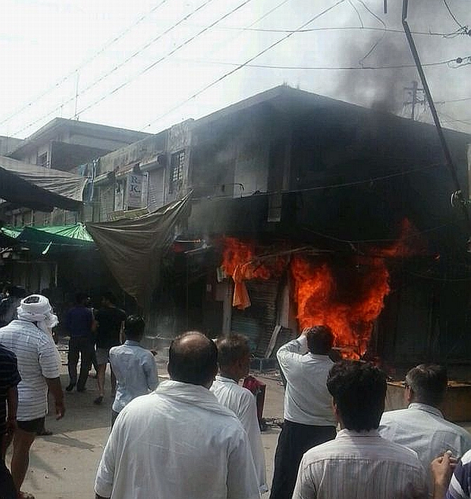 Shops were set on fire after two groups clashed in Saharanpur