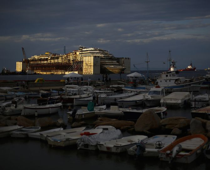 The Costa Concordia cruise liner is seen during its refloat operation at Giglio harbour, during one of maritime's largest salvage operations in history.