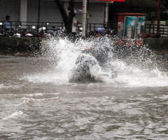 India News - Latest World & Political News - Current News Headlines in India - PHOTOS: In Mumbai, when it rains, it pours!
