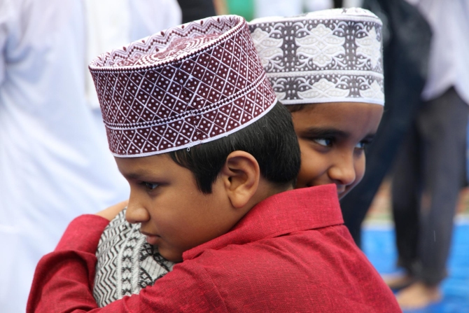 Young boys congratulate each other after saying their Eid-ul-Fitr prayers in Thane.