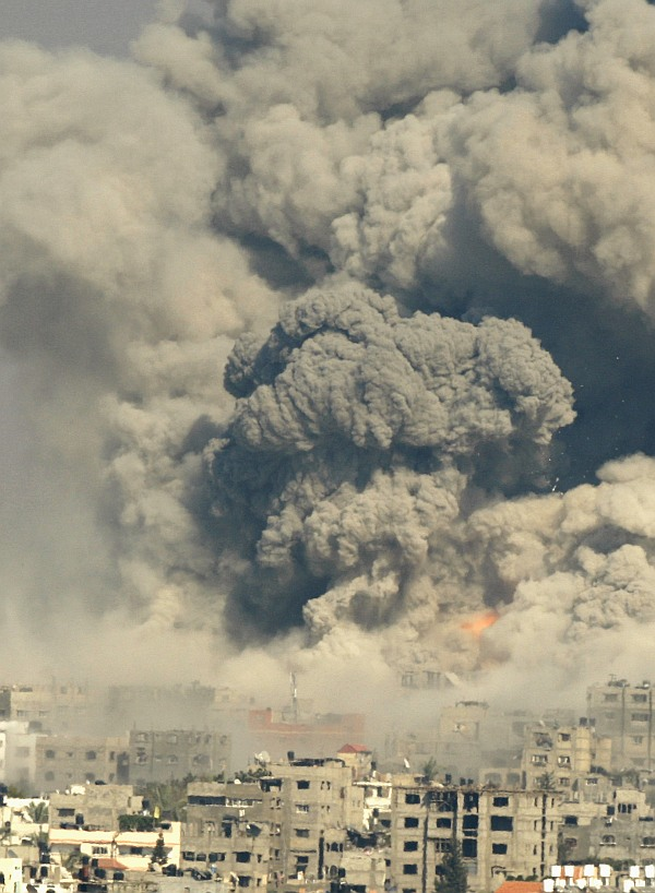 Smoke rises following what witnesses said were Israeli air strikes in the east of Gaza City