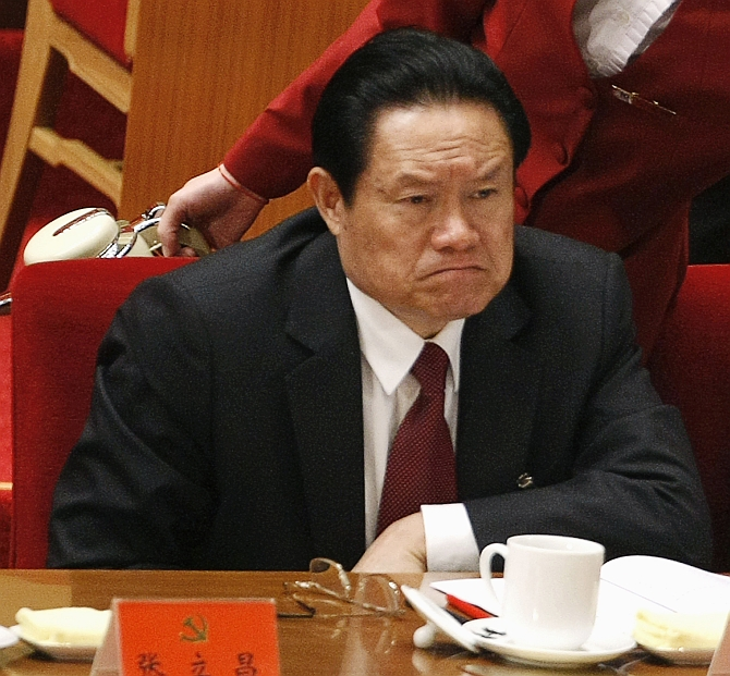 China's then public security minister Zhou Yongkang attends the opening ceremony of the 17th National Congress of the Communist Party of China at the Great Hall of the People, in Beijing in this October 15, 2007