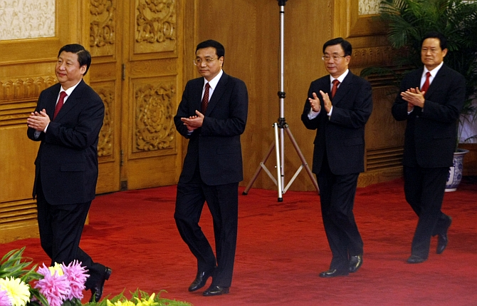 Chinse President Xi Jinping, Premier Li Keqiang, retired high-ranking official in the Communist Party of China He Guoqiang and Zhou Yongkang meet with the media at the Great Hall of the People in Beijing in October 22, 2007