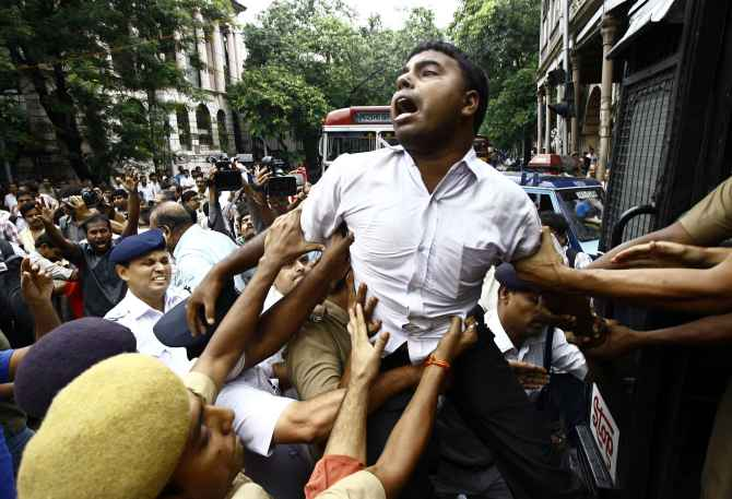Activists of Socialist Unity Centre of India in Kolkata being detained by police during a protest against the recent rail fare hike
