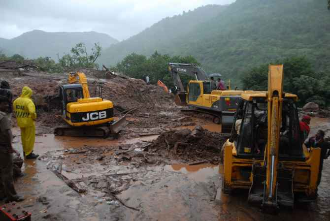 JCB machines engaged in rescue and relief work at the site of the landslide near Pune